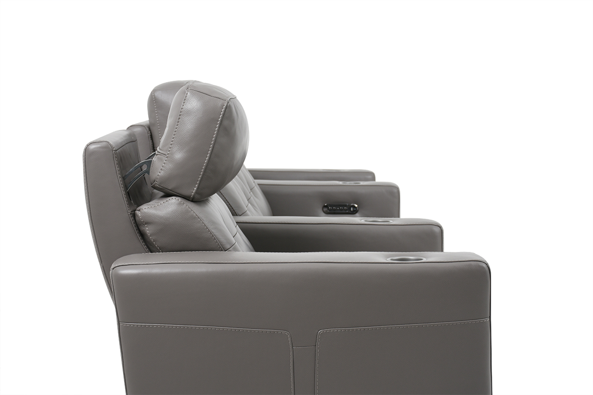 Dual motor for independent control of the recliner and the headrest